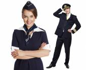 Captain of the aircraft and a beautiful flight attendant in a da — Stock Photo