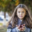 Beautifal little girl in the autumn park — Stock Photo #77960488