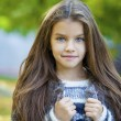 Beautifal little girl in the autumn park — Stock Photo #77960490