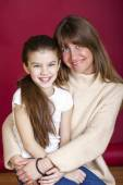 Portrait of seven year old daughter and mom — Stock Photo