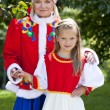 Portrait of mother and daughter in a national Russian costume — Stock Photo #78149104