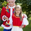 Portrait of mother and daughter in a national Russian costume — Stock Photo #78149106