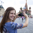 Young woman photographed attractions in Moscow — Stock Photo #78733564