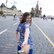Young happy girl pulls the guys hand on the Red Square in Moscow — Stock Photo #78733644