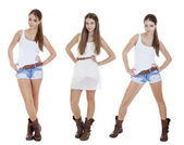 Portrait in full growth the young girls in blue jeans short — Stock Photo