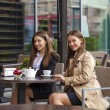 Two young business women having lunch break together — Stock Photo #79158488