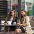 Two young business women having lunch break together — Stock Photo #79158562