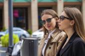Two young beautiful business women in sunglasses — Stock Photo