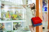 Shopping, young beautiful woman on the background showcases a sh — Stock Photo