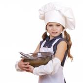 Little girl cook whips whisk eggs in a large plate — Stock Photo
