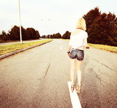 Young beautiful girl on the road — Stock Photo
