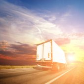 Truck with freight moving fast — Stock Photo