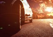 Black car driving fast — Stock Photo
