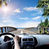 Driver hands on steering wheel — Stock Photo