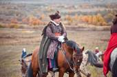 Horse-hunting with man in riding habit — Stock Photo