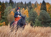 Horse-hunting with ladies in riding habit — Stock Photo