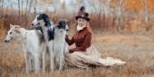 Portrait of LadyXIX Century  with russian borzoy dogs — Stock Photo