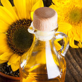 Sunflowers with oil — Stock Photo