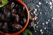 Sun-dried olives in bowl — Stock Photo