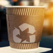 Coffee cup with recycling sign — Stock Photo