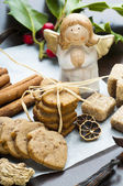 Ginger cookies and angel statuette — Stock Photo