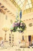 Table with flowers in banquet hall — Stock Photo