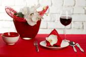 Table setting with orchid flowers — Stock Photo