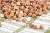 Buckwheat groats in scoop — Stock Photo