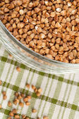 Buckwheat groats in bowl — Stock Photo