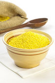 Millet grains in bowl — Stock Photo