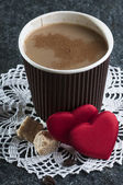 Coffee with milk and hearts — Stock Photo