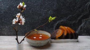 Apricot flowers, tea and orange marmalade — Stock Video