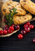Fresh cowberries with cookies — Stock Photo