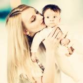 Mother kissing little child — Stock Photo