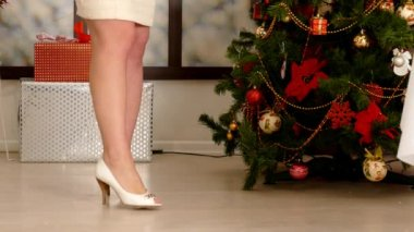 Beautiful woman hiding Christmas presents — Video Stock