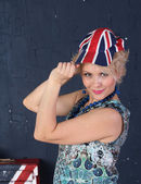 Adult woman in union jack cap — Stock Photo