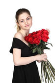 Beautiful brunette with a bouquet of roses — Stock Photo