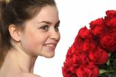 Beautiful girl face with set of roses — Stock Photo