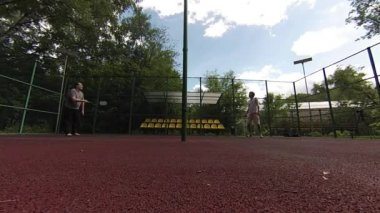 Two men playing Badminton on court — Stock Video