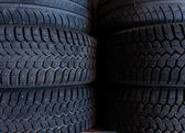 Tire stack background.  Selective focus. — Stock Photo