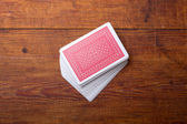 Palying cards on wooden table — Stock Photo