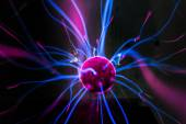 Plasma ball  with magenta-blue flames isolated on a black background. — Stock Photo
