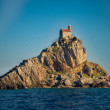 The Mali Katic island with the small church on the top is famous tourist destination and swallows nesting place, Montenegro. — Stock Photo #68901057