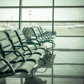 Airport waiting area , seats and outside the window scene — Stock Photo