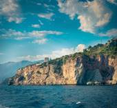 The high cliffs next to the central beach of Budva make the coastline even more scenic and romantic for boat trips, Montenegro. — Stock Photo
