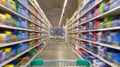 Shopping Cart View on a Supermarket Aisle and Shelves - Image Ha — Stock Photo