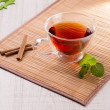 Cup of tea with cinnamon and mint — Stock Photo #73040479