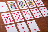 Playing cards on wooden background,playing cards for valentines day — Stock Photo