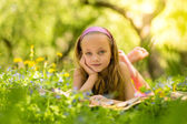 Happy little girl at the park — Stock Photo
