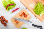 Tomato, toasts, meat and salad on wooden table — Stock Photo